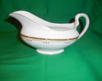One (1), Gravy Boat, from Johnson Bros., in the JB 653 Pattern.