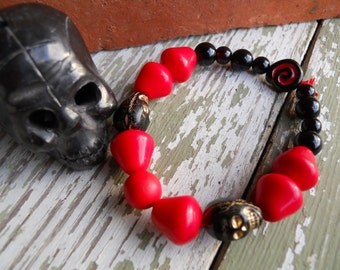 The Real Dia de Los Muertos Cardinal Colors Skull bracelet in University of Louisville colors