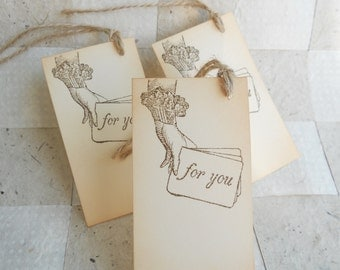 Wedding gift favors, thank you tags hand stamped with a jester's hand holding 'for you' or 'Thank you' cards, tied w/twine, set of 24