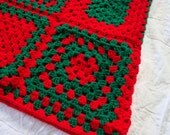 Crochet Granny Square afghan blanket in Christmas colors of bright red and green.