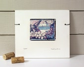 """Grapes.  Still Life:  """"After The Party.""""  Empty Glass, Wine Bottle, Etiquette Books.  Polaroid Transfer on Clay."""