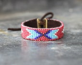 Handwoven bracelet with red beads and indian pattern / leather inside and fastening