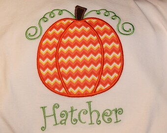 Appliqued Pumpkin t shirt with or without name.