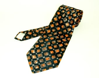 1970s Wide Black & Orange Tie Mens Vintage Disco Era Textured 100% Polyester Super Wide Necktie with abstract geometric designs by PHILIPPE