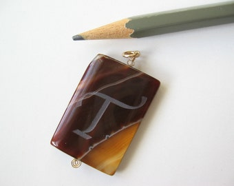 Agate pendant stone with sandblasted initial T