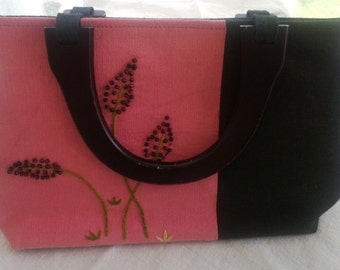 Clutch bag with wooden handles, black and rose colored,beaded flower design