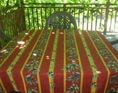 100% Cotton Tablecloth with Olives and green leaves .