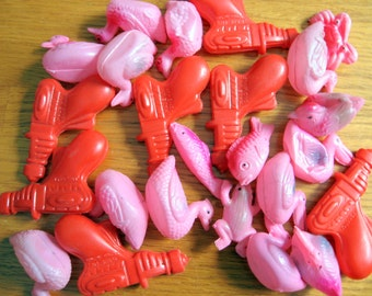 1960s Lot of 24 Celluloid Pink and Red Guns and Animals