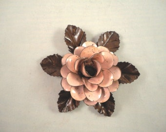 Medium Size Decorative Metal Hand Cut and Hand Painted Rustic Light Pink Color Rose Mounted on a Bed of Leaves.