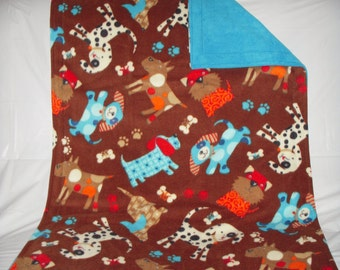 Doggy Blanket - adorable playful puppies on brown with reversible solid turquoise blue fleece