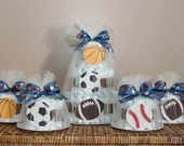 Sports themed diaper cake centerpiece and smaller cakes