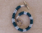 7 inch Kumihimo bracelet in teal green and pearlized white  seed beads.
