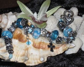 Beautifully Handmade Baby Blue and Silver Charm Bracelet.