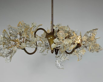 Lighting hanging chandeliers with Transparent leaves and flowers with 3 arms, over a dinning table or bedroom.