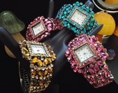 pink, gold and teal, fantasticly flashy rhinestoned clasp watches