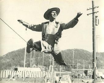 Man cowboy circus performer tight rope walker vintage photo