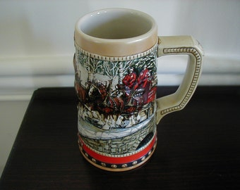 Very decorative Anheuser-Busch, Inc. Stein.  Clydesdales decorate this stein and it is stunning. Made in 1988 especially for Anheuser-Busch.