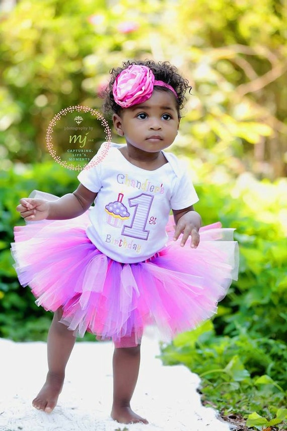 First Birthday girls tutu out fit, buy 1 part or buy it all. Personaized, cup cake and the number 1 in bright birthday colors.