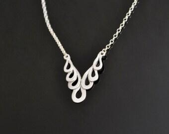 Cascade Silver Pendant. Flowing hoops pattern