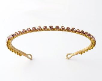 Elsie - a simple and beautifully understated hairband of sparkling pale pink vintage rhinestones set into an unusual goldtone garland.
