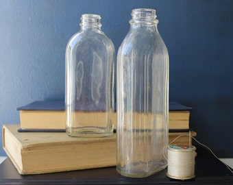 Pair of Uniquely Striped Vintage Clear Glass Bottles