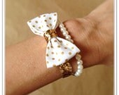 White and Metallic Gold Polka Dot Bow Bracelet with Gold Glitter Band