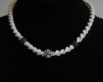 Hemp necklace with carved bone beads
