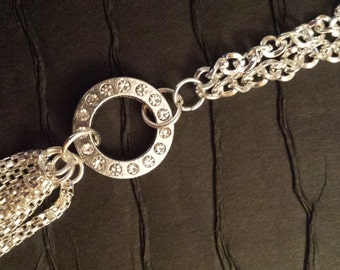Long multiple silver chain necklace with a c ring