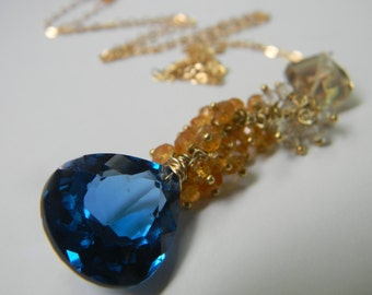 SALE. necklace. london blue topaz. orange garnet. oregon sunstone.