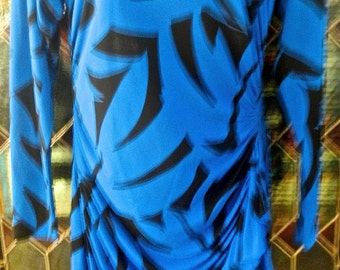 a silk Neiman Marcus dress from the 70s in blue and black,great shape!