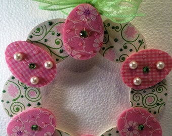 Hang this light weight Decorative Easter Egg wreath on a door, wall or from a suction cup in your window.