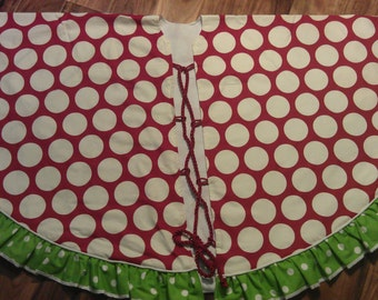"""60"""" Red & Green polka dot tree skirt with ruffle, piping and red cord closures. Top is medium weight duck fabric, back is muslin."""