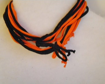 Black and orange tee shirt necklace, with bows