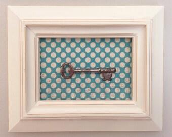 Antique upcycled skeleton key on polka dot in frame