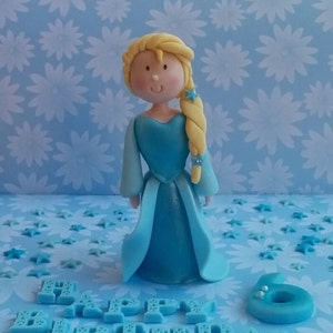 Queen Elsa (FROZEN) inspired fondant cake topper