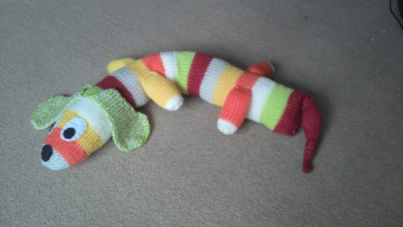 Knitting Patterns For Sausage Dogs : Knitted stripy sausage dog