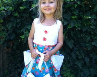 Cute little girls dress with matching cat faced purse