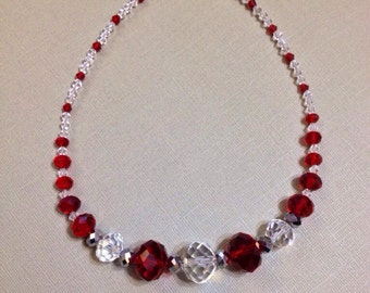 Crystal necklace, red and clear with silver accents