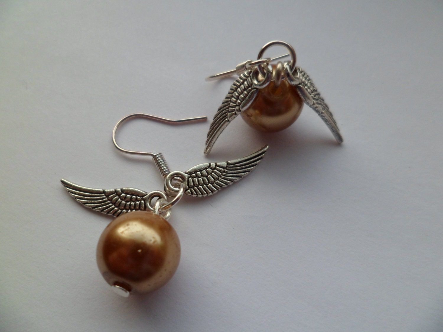 golden snitch earrings golden snitch earrings inspired from the harry potter 405