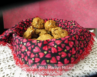 """Hearts fabric basket liner or table centerpiece mat, (lined), round, reds, white, lace, black, gold, 16"""" in diameter."""