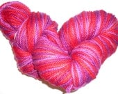Berry Brights, a unique skein of hand-dyed bluefaced leicester wool yarn