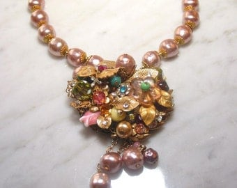 Miriam Haskell pearl necklace with floral / jeweled cluster pendant