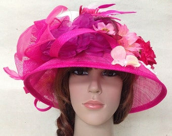 A Fuchsia Sinamay Church Or Tea Hat With Flowers,Mesh And Feather.