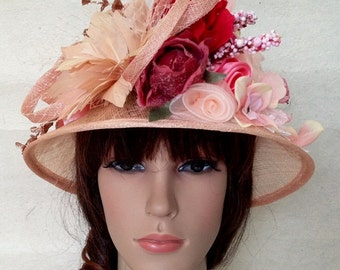An Apricot Orange Sinamay Bowler Derby Church Hat With Sinamay And Fabric Flowers.
