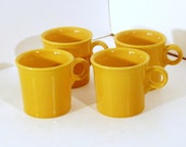 4 Fiesta Yellow cups, all perfect and ready for a new home.