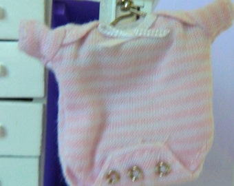 Onesy for baby with snaps, bow and hanger dollhouse miniature 1/12 scale
