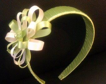Elegant green headband accented with ivory ribbon and tiny glass beads