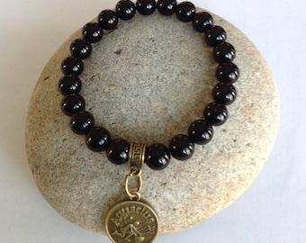Aquarius Zodiac Beaded Bracelet. Black jasper beads. Antique bronze charm w/bail. Stretch bracelet. Minimalist. January 20 - February 18.