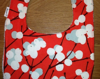 Orange Lumimarja bib for a girl, Marimekko cotton fabric, Finland