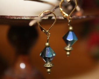 Iridescent blue crystal beacon shaped earrings.